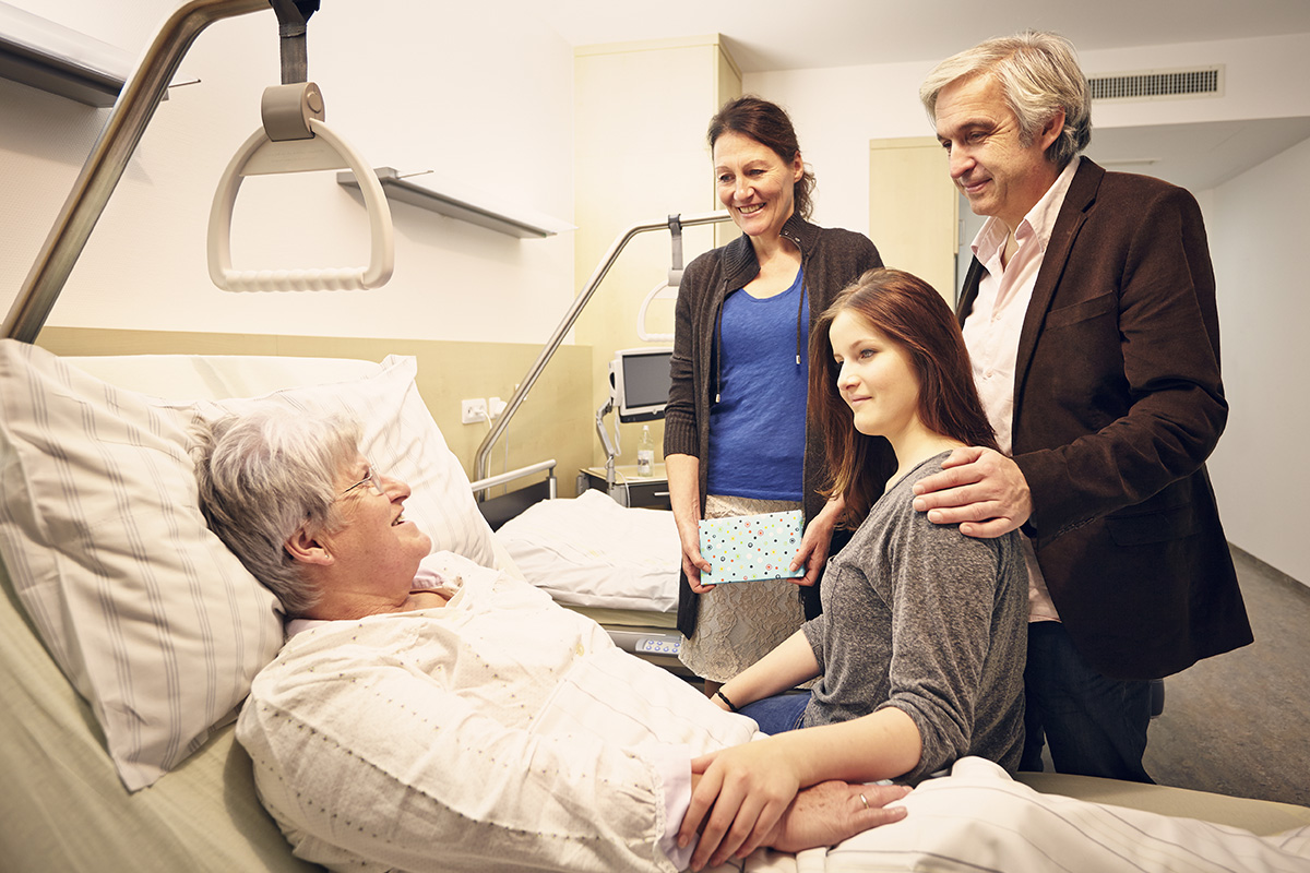 Family talking to patient